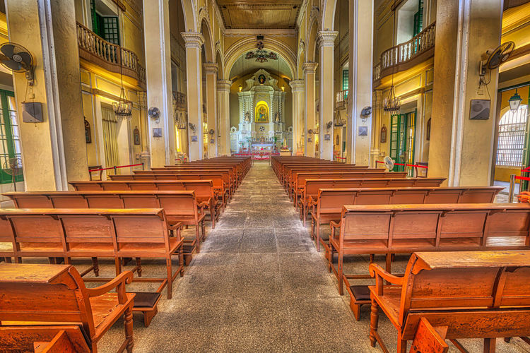 Macau, China - December 8, 2016: interior of Saint Dominics Church, baroque style cathedral at Senado Square in Historic Centre of Macau, Unesco Heritage Site, one of major tourist attractions. Macao  Hotel Skyline Galaxy Saint Dominic's Church Saint Dominic's Church Interior Religion Mass Architecture Chinese China Built Structure Building Place Of Worship Spirituality Arch Indoors  Seat Pew Day The Way Forward In A Row Belief Empty Direction No People Architectural Column Aisle Ceiling