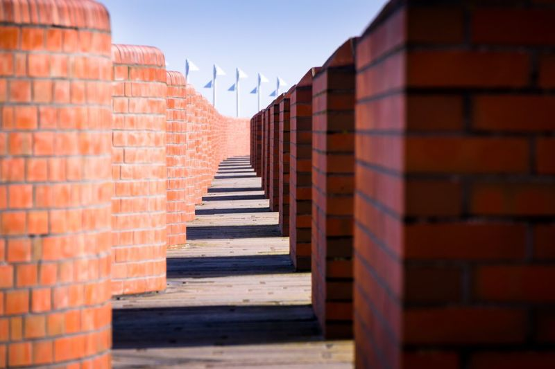 Wellenbrecher an Promenade auf Norderney Promenade Schatten Backsteinmauer Backstein Fries! Northsea Nordicsea Nordseeküste Nordsee Norderney EyeEm Selects Architecture Brick Brick Wall In A Row Built Structure Day No People Wall Sunlight Wall - Building Feature Shadow Building Exterior Direction Sky Repetition Red Outdoors Nature The Way Forward