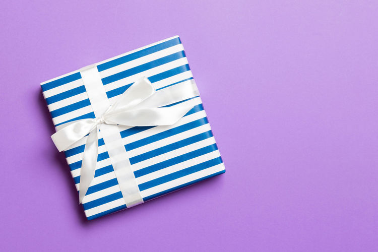 Low angle view of white box against blue background