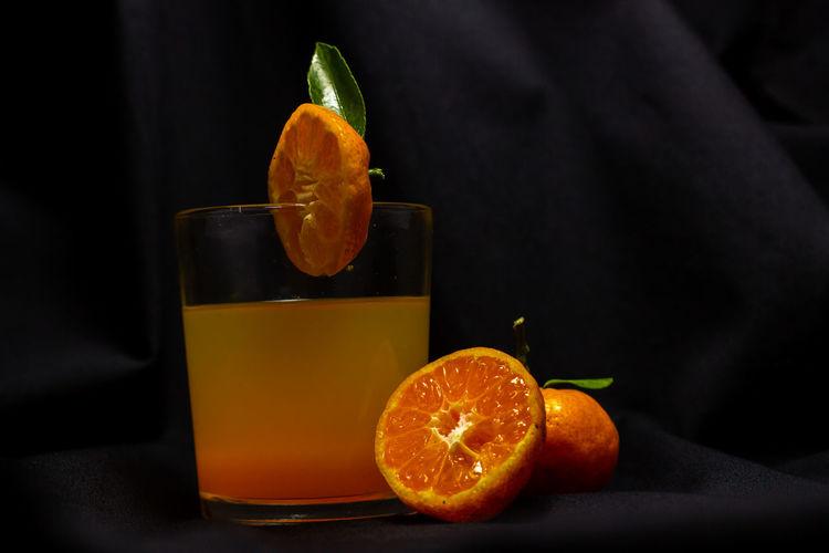 Orange slice in glass on table