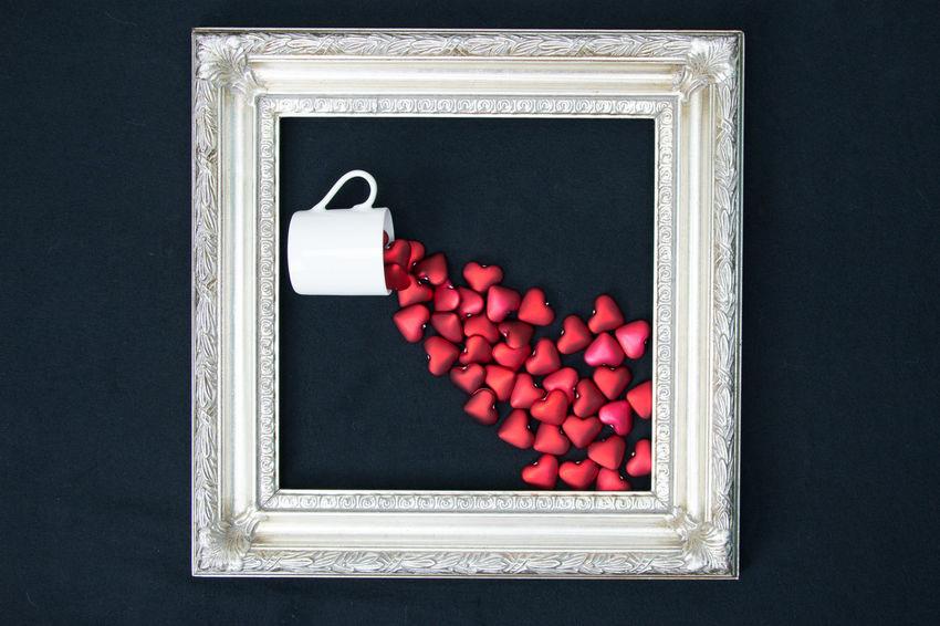 Love spilling over Framed Love Overflow Romance Valentine Black Background Hearts Indoors  Love ♥ No People Red Spill Studio Shot