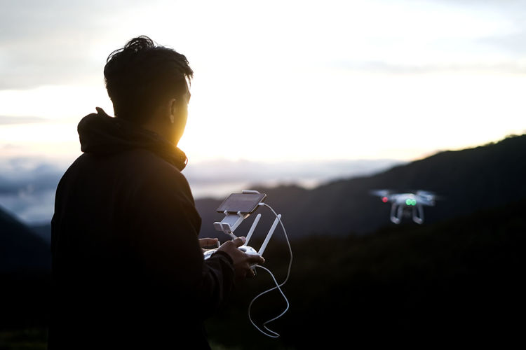 men fly drones, on mount bromo. Sky Camera - Photographic Equipment Mountain Technology One Person Nature Leisure Activity Scenics - Nature Lens Flare Beauty In Nature Lifestyles Holding Adult Cloud - Sky Sunset Men Photographic Equipment Outdoors Photographer Digital Camera Bromo Drone  Dji Droneshot Dronephotography