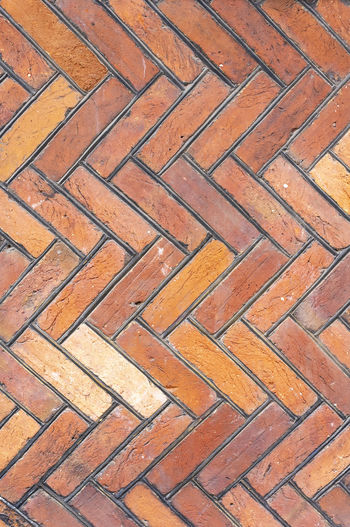 Herring bone pattern brick wall Tudor Abstract Architectural Feature Architecture Backgrounds Brick Brown Close-up Color Day Design Footpath Full Frame Herring Bone No People Outdoors Pattern Red Repeat Pattern Repetition Shape Structure Style Textured