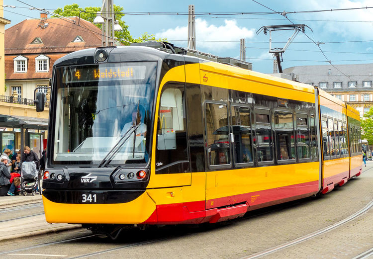 a tram in Karlsruhe Karlsruhe, Architecture Built Structure Cable Day Germany Land Vehicle Mode Of Transport No People Outdoors Public Transportation Sky Tram, Train, Locomotive, Traffic, Public Transport, Travel, Transportation Yellow