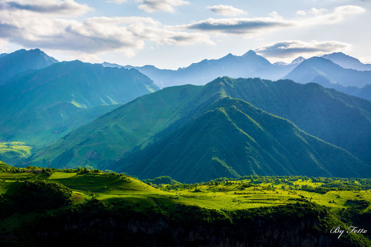 Agriculture Beauty In Nature Day Georgia Kazbegi Mountains Landscape Lomisa Lush - Description Lush Foliage Mountain Mountain Range Nature No People Outdoors Rural Scene Scenics Sky Sport