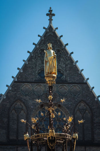 Architecture Building Exterior Built Structure Clear Sky Close-up Day Den Hague Gold Colored Low Angle View No People Outdoors Place Of Worship Religion Sky Spirituality Statue
