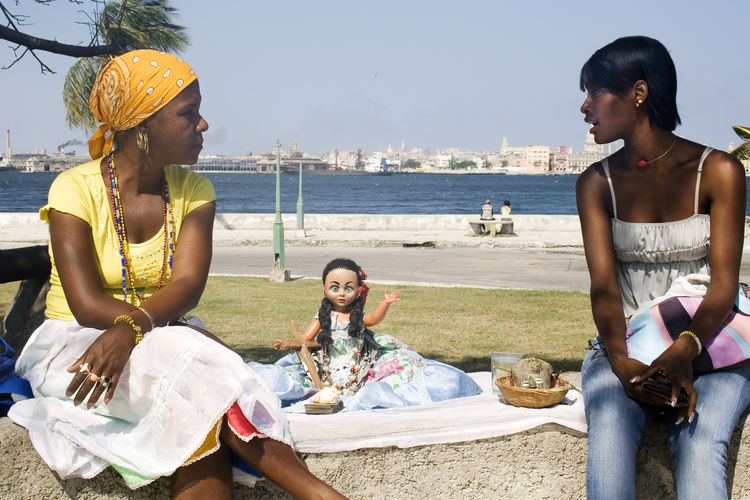 Adult Afrocuban Cultures Ocha Only Women Orisha Orishas Outdoors People Real People Regla Religious  Santera Santeria Sitting Traditional Clothing Virgen De Regla Yemaya Uniqueness
