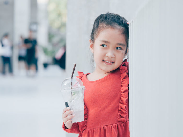Portrait of smiling girl holding drink