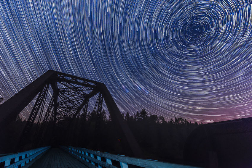 Playing stars Night Photography Nikon D750 Polaris Quebec Tamron 15-30mm Astronomy Beauty In Nature Bridge Canada Cold Temperature Galaxy Landscape Lighted Bridge Long Exposure Nature Night North Star Northern Star Outdoors Scenics Sky Space Star - Space Star Trail Tree