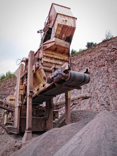 portable stonecrusher machine in a quarry. mining industry Pit Rocks Steine Stone Crusher Steinbrecher Construction Material Conveyor Belt Förderband Conveyorbelts Construction Materials Rock Formation Bergbau Steinbruch Mine Mining Quarry Open Pit Mine Stones Porphyry Loading Zone Loading