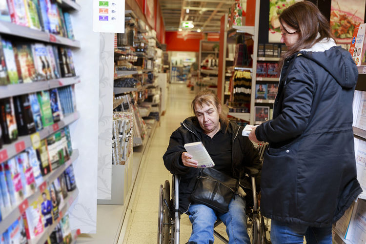 Woman using mobile phone at store