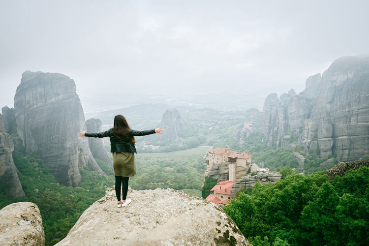 Backpack Beauty In Nature Day EyeEmNewHere Greece Hiking Landscape Leisure Activity Lifestyles Looking At View Meteora Mountain Mountain Range Natura Nature Nature Beauty One Person Real People Rear View Rock - Object Scenics Standing Sunset Woman A New Perspective On Life