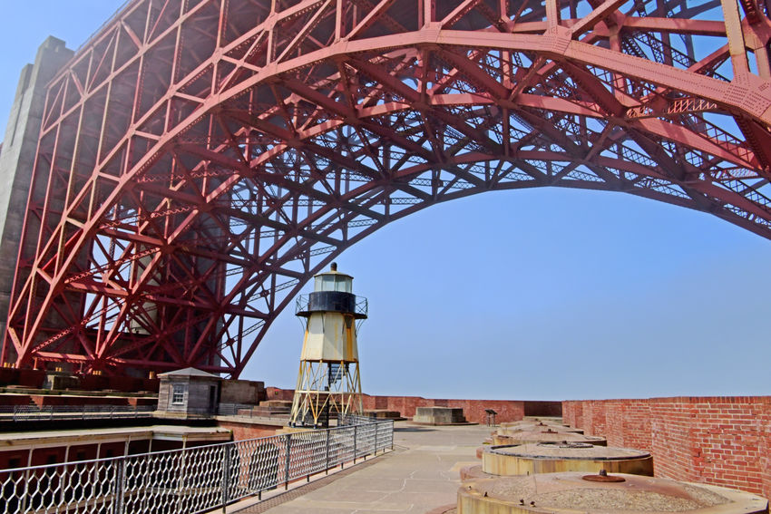Golden Gate Bridge @ Fort Point 16 Golden Gate Bridge Built 1937 Bridge Arch Fort Point Lighthouse Forts Rooftop Close-up Cannon Mounts Parapet Wall Penthouse Fog Architecture Architectural Detail Bridge Steel Structure  Arches Archways BarracksBrick And Mortar Low Angle View Bridge Span