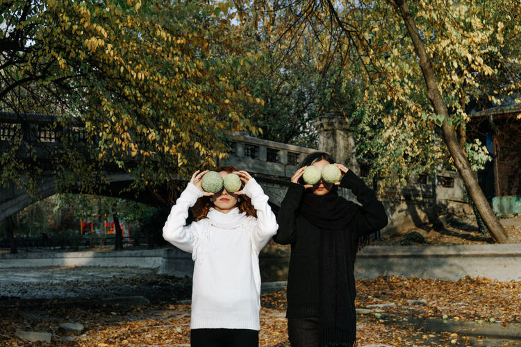 Park Park - Man Made Space Hiding Young Women Sisters Twins Autumn Tree Women Standing Water Togetherness Happiness Photography Themes Fallen Leaf Fall Autumn Mood 50 Ways Of Seeing: Gratitude 2018 In One Photograph #NotYourCliche Love Letter
