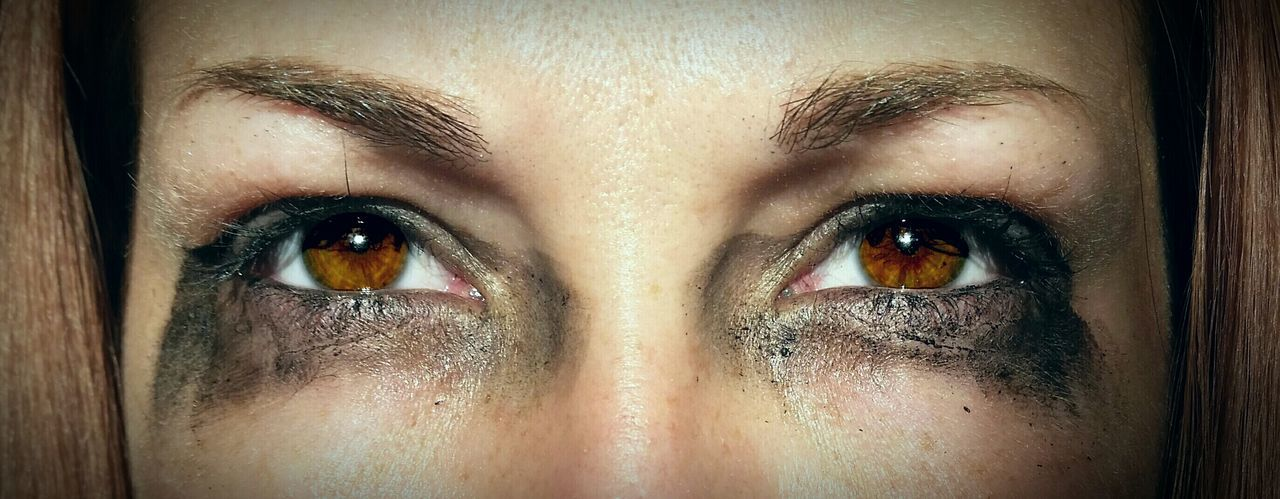 Close-up of woman with smudged mascara