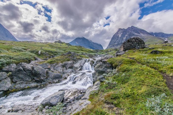 Mountain Beauty In Nature Nature Sky Mountain Range Cloud - Sky Rock - Object Outdoors Water Lappland Fjallravenclassic Hiking Sweden Waterfall Stream