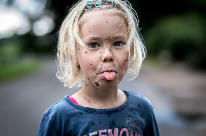no comment ... ;) Blue Eyes EyeEm Best Shots Fun Girl Power Kids Kids Being Kids Blond Hair Casual Clothing Childhood Close-up Cute Day Dirt Dirty Focus On Foreground Front View Girls Headshot Innocence Looking At Camera One Person Outdoors Portrait Real People Tongue EyeEm Ready