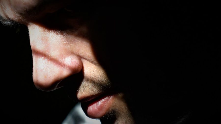 Close-Up Of Man Looking Away In Darkroom
