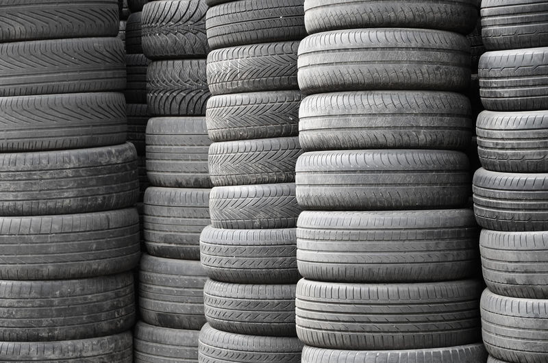 Tyre Tire Old Car Bad Used Stack Pile Automobile Heap Lot Rubber Group Dump Truck Cover Condition Worn Abstract Auto Automotive Background Black Case Casing Detail Dirty Environment Garbage Industrial Industry Large Many Material Nobody Obsolete Pattern Piled Recycle Recycling Repair Season  Stacked Texture Transport Transportation Useless Vehicle Waste Wheel