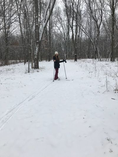 Full Length Teenage Girl Skiing On Snow Covered Field