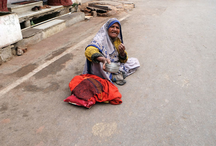 Beggar waits