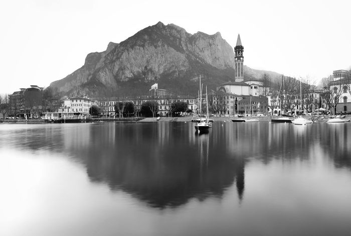 Reflection Water Outdoors No People Mountain Harbor Architecture Nautical Vessel Day Sky Nature Cityscape Winter_collection Tranquil Scene Landscape Lombardy Lake Como Lake Lake Como Italy Italy Italia Lecco Lecco Lake Blackandwhite Black & White