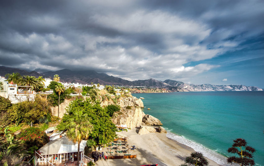 Calahonda beach, located in the centre of Nerja town. Spain Andalucía Beach Calahonda Cloudy Sky Coast Coastline Costa Del Sol Dramatic Sky Landscape Mediterranean Sea Moody Sky Nature Nerja Outdoors Rocky Coastline Rocky Mountains Sand Seaside SPAIN Stormy Sky Sunny Day Tourist Resort Town Travel Destinations Turquoise Water