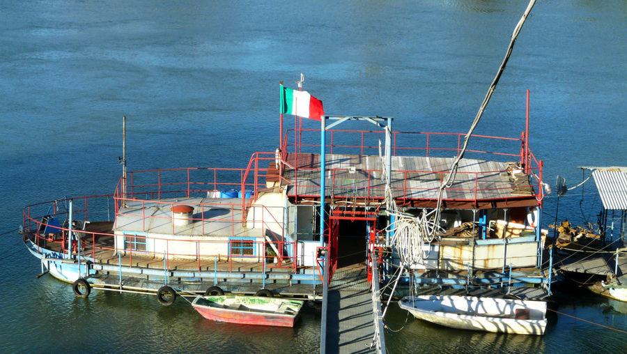High angle view of fishing boats moored at sea