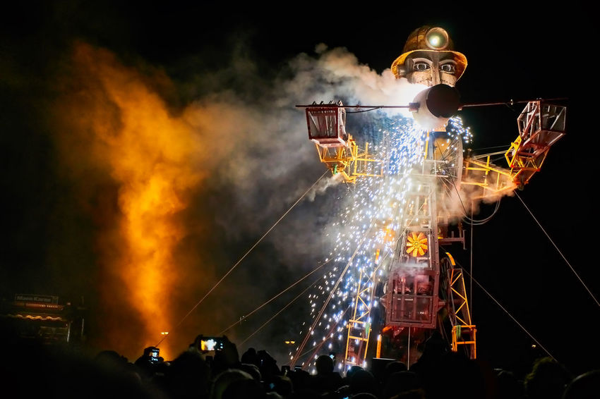 Architecture Arts Culture And Entertainment Burning Crowd Event Fire Glowing Group Of People Illuminated Large Group Of People Leisure Activity Lifestyles Manmachine Men Motion Nature Night Nightlife Occupation Outdoors Real People Smoke - Physical Structure Spraying Themanengine