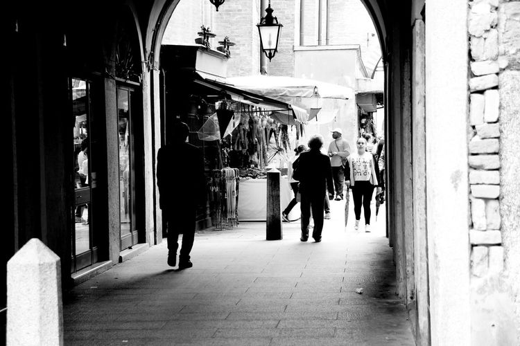 Arch Architectural Column Architecture B&w Black And White Built Structure City Life Corridor Day Full Length Halfway Leisure Activity Lifestyles Street Photography The Way Forward Monochrome Photography