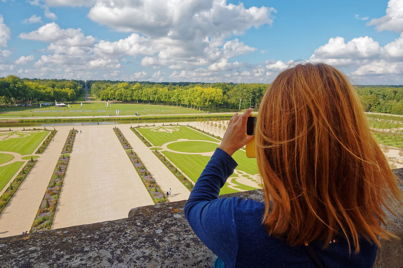 Chateau De Chambord Agriculture Beauty In Nature Château Cloud - Sky Day Field Grass Landscape Leisure Activity Lifestyles Long Hair Nature One Person Outdoors People Photographing Real People Rear View Scenics Sky Standing Tree Women Young Adult