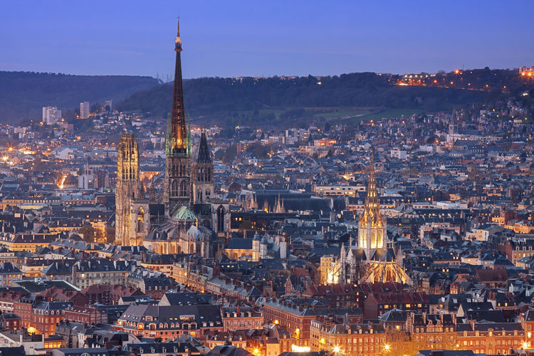 Rouen, france: skyline of the city at dusk Rouen Rouen, France Blue Hour Cityscape Dusk Dawn Skyline City Medieval Normandy Church Travel Destinations Travel Illuminated High Angle View Architecture Building Exterior Outdoors Tower No People Architecture Ancient France