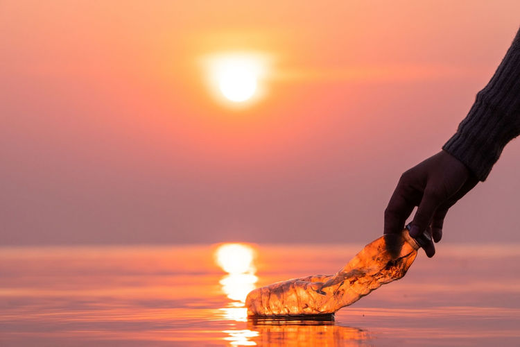 Sunset Sky Nature Water Human Hand Reflection Lifestyles Garbage Environment