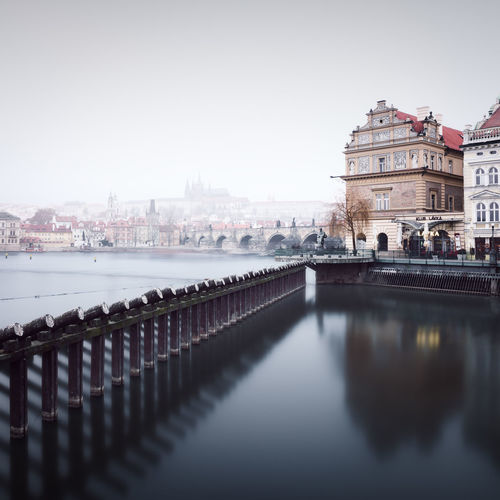 View on the Charlesbridge and Prague Castle Architecture Bridge - Man Made Structure Charles Bridge City Cityscape Czech Republic Day Fineart Foggy Day Karlův Most Long Exposure Muted Colors Outdoors Philipp Dase Prague Prague Castle Prague Old Town Praha River Travel Destinations Water Winter In Prague Winter In The City Winter Landscape Paintthetownyellow