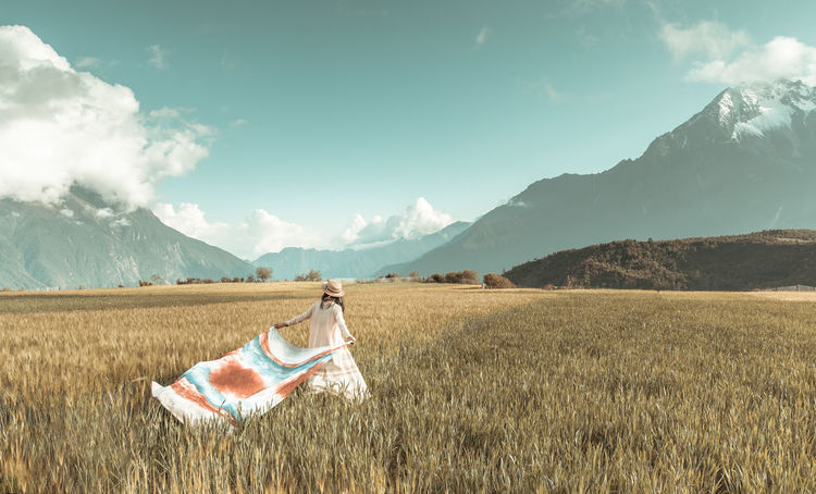Beautiful girl walking through the wheat field Beauty Blowing Chinese Girl Cloud - Sky Field Field Girl Landscape Lifestyle Photography Modelgirl Mountain Nature One Person Outdoors Pretty Girl Romantic Landscape Running Scarf Sky Travel Photography Trip Walking Wheat Woman Young Adult