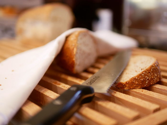wholewheat bakery Table Knife Breakfast Healthy Eating Wellbeing No People Still Life Table Cutting Board Wood - Material Selective Focus Freshness Indoors  Bread Food And Drink Kitchen Knife Loaf Of Bread Food Close-up SLICE Knife Cheese Dairy Product Bun Snack