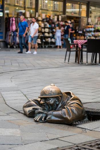 Male statue in manhole