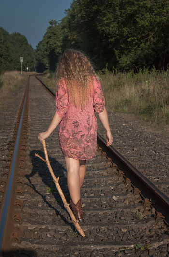 Beautiful Day Beautiful Woman Blond Hair Day Enjoying The Sun Full Length One Person Outdoors People Rail Transportation Railroad Track Railway Track Real People Rear View Sky Transportation Tree Walking Walking Around Long Hair Summertime Young Women Young Adult Lifestyles Beautiful Girl