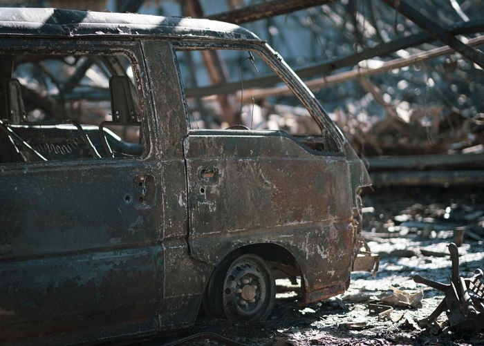Fire Damage Bad Condition Burnt Burnt Out Van Damaged Day Decline Demolished Destruction Deterioration Focus On Foreground Junkyard Land Vehicle Metal Mode Of Transportation No People Obsolete Old Outdoors Ruined Run-down Rusty Transportation Weathered