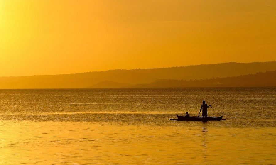 Color Palette silhouette of fishermen against the orange-colored sky. Sunset Sunset Photography Silhouette And Sky Sun Orange Color Orange Sky Fishing Boat Fishermen Boat Fishing Enjoying Life