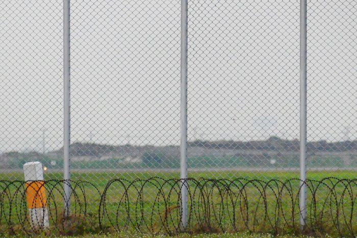 Imprisonment Barbed Wire Chainlink Fence Close-up Day Fence Field Forbidden Greenhouse Imprisonment Metal No People Outdoors Protection Safety Security Sky รั่ว ลูกกรง