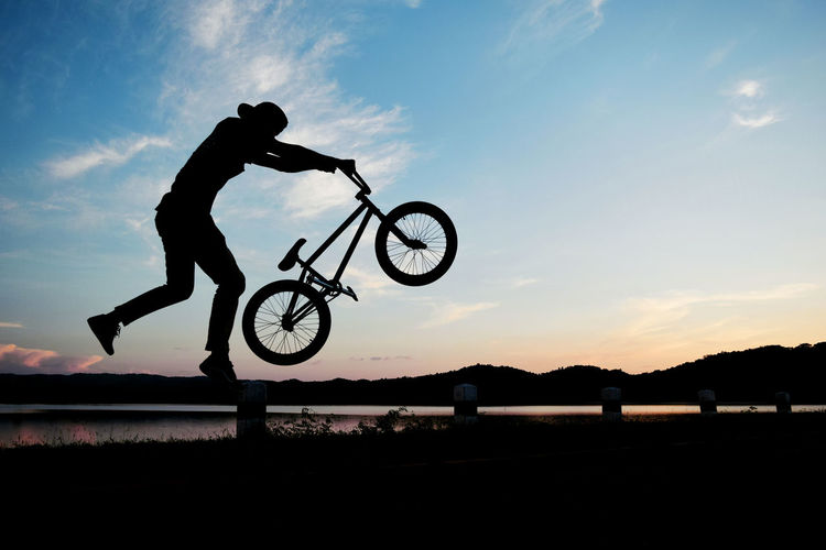 Silhouette Of Man With A Bmx Bicycle