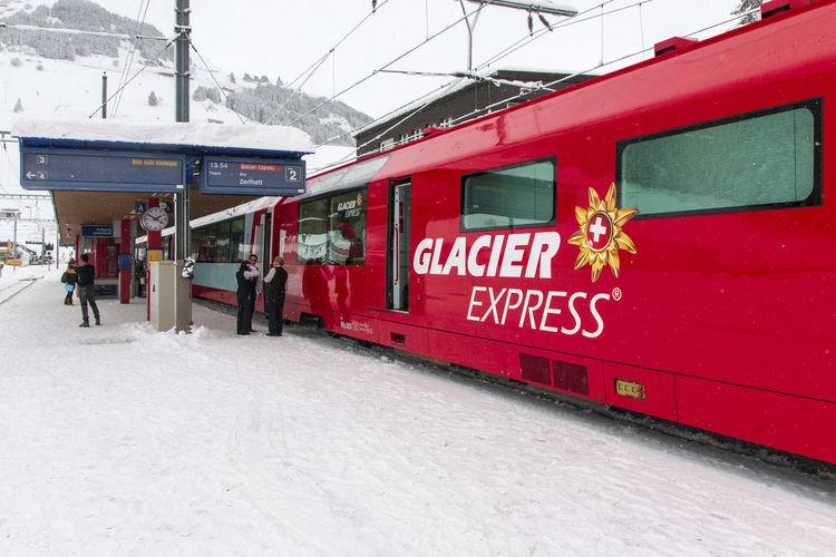 The Glacier Express parked in Andermatt - Switzerland Glacier Express Train  Zermatt Alps Andermatt  Glacier Express Mode Of Transportation Public Transportation Snow Snowing Swiss Train Transportation Winter