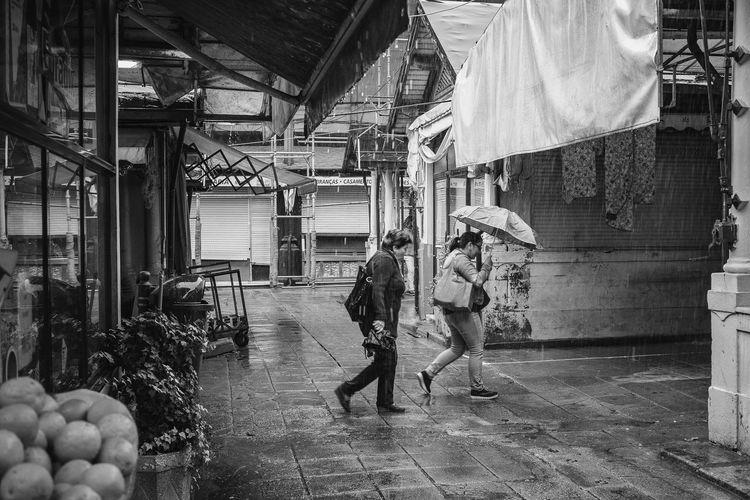 Under rain Architecture Day Full Length Market Marketplace Mercado Do Bolhão Monochrome Photography Old Person Rain Rainy Days Retail  Walking Women