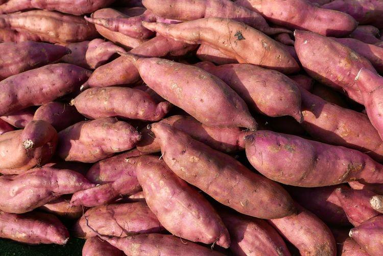 Full frame shot of sweet potatoes at market