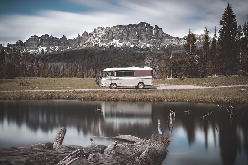 Exploring all that Wyoming has to offer. Travel Destinations Get Away Camping NOMAD Tranquil Scene Day Sky Outdoors No People Wyoming Recreational Vehicle Rv Campervan Vanlife Waterfront Non-urban Scene Motor Vehicle Mountain Land Vehicle Reflection Lake Water EyeEmNewHere