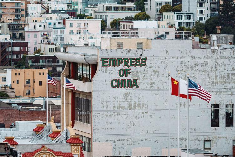 Flags on street against buildings in city