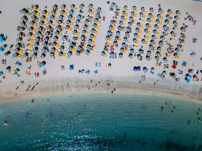 Crowd Large Group Of People Group Of People Real People Leisure Activity High Angle View Sport Lifestyles Multi Colored Enjoyment Day Land Water Men Celebration Mixed Age Range Beach Fun Outdoors