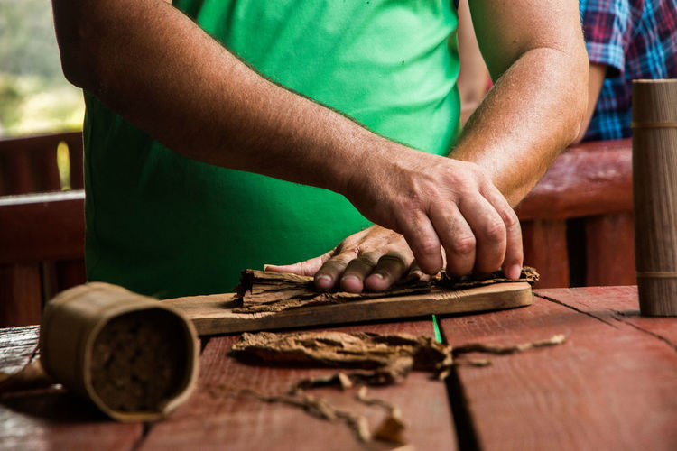 Adult Cigar Close-up Cuba Day Human Body Part Human Hand Indoors  Making A Cigar Men Musical Instrument Occupation One Person People Real People Standing Tabacco  Wood - Material Work Tool Working Workshop