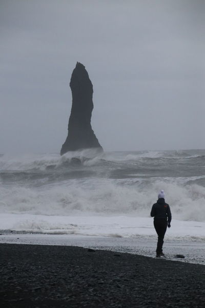 Rock Beach Beauty In Nature Black Horizon Over Water Nature One Person Outdoors Real People Rear View Rock In Sea Sand Sea Sky Standing Walking Water Waves White Vik Vík í Mýrdal Reynisdrangar Reynisdrangar Cliffs Lost In The Landscape